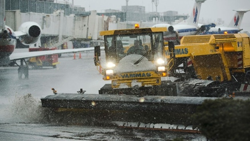 Feb. 8: Grounds crews clear the tarmac at LaGuardia Airport in New York.