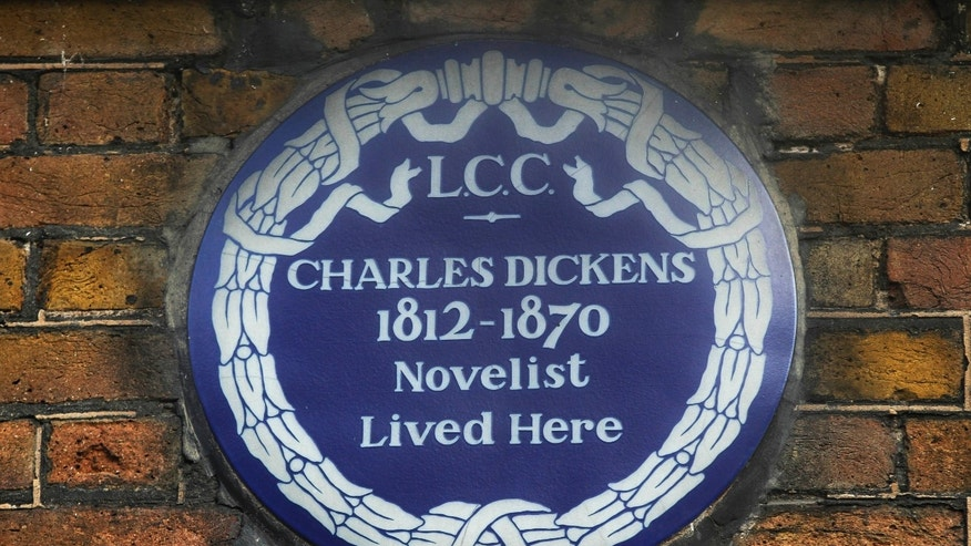 FILE - In this Dec. 5, 2012 file photo, a blue plaque is seen on the exterior of Charles Dickens' home, part of the Charles Dickens Museum in London.