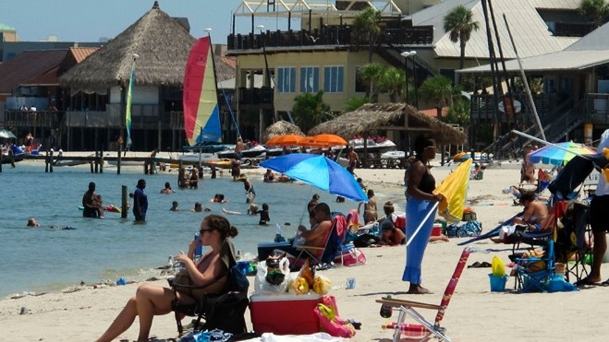 Aug. 28, 2011: Tourists as they sit on the beach at Pensacola Beach, Fla.