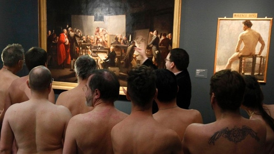 "Feb. 18, 2013: Naked Museum visitors look at pictures of the show ""Nude Men from 1800 to Today"" during a special opening to friends of nudism at the Leopold Museum, Vienna, Austria."