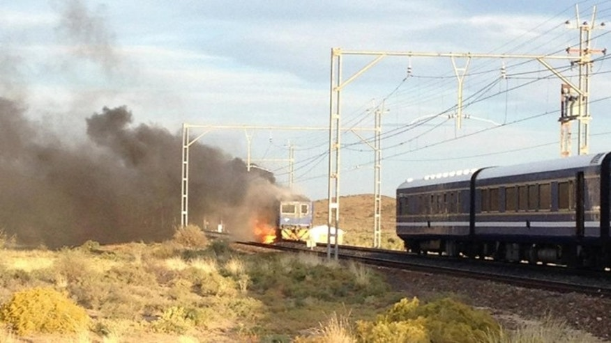 The famous Blue Train burns as the rest of its cars are finally unhooked.