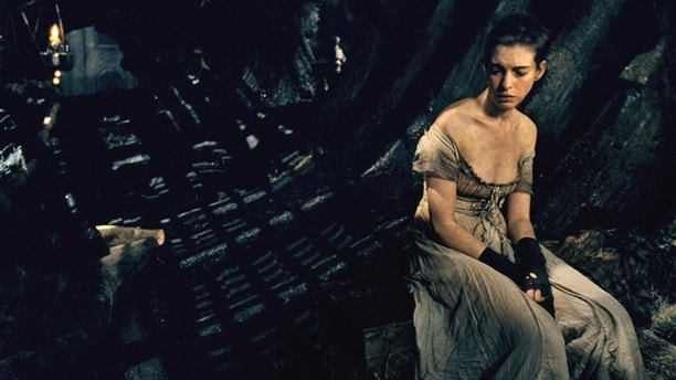 """This image released by Universal Pictures shows Anne Hathaway as Fantine in a scene from """"Les Misérables.""""  The costumes for the film were designed by Spanish designer Paco Delgado. Delgado is nominated for an Academy Award for his costumes from the film. The 85th Academy Awards will be held on Sunday, Feb. 24. (AP Photo/Universal Pictures)"""