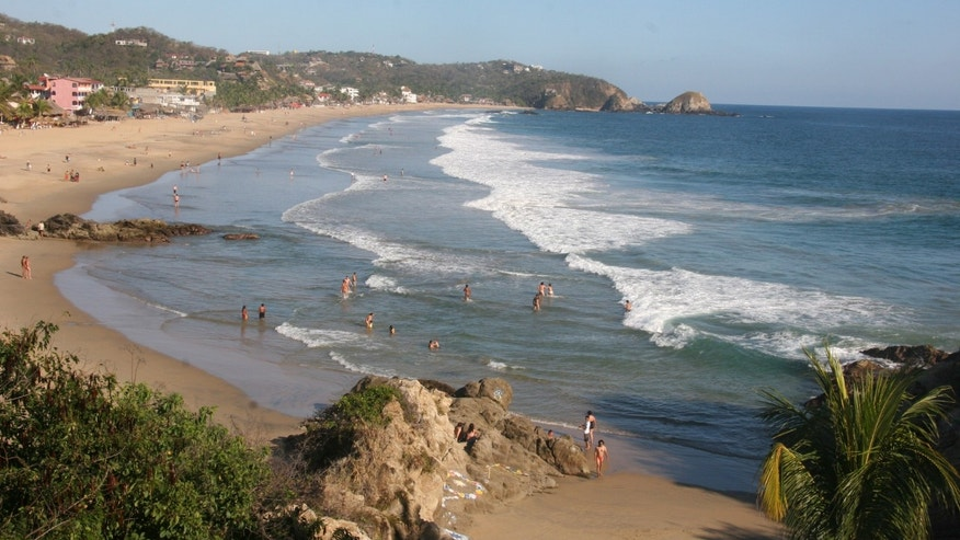 Jan. 6, 2013: Visitors bathing in the surf along the beach in Zipolite, Mexico.