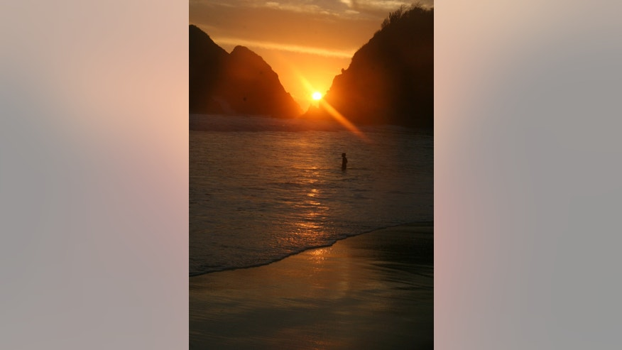 Jan. 5, 2013: A lone swimmer wading into the surf during sunset in Zipolite, Mexico.