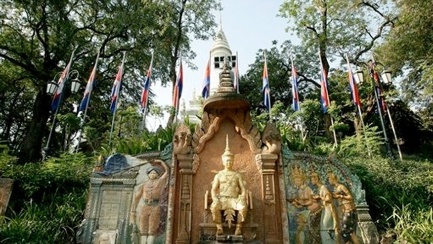 Feb. 25, 2013: The statue of former King Sisowath, center, is displayed at Wat Phnom, in Phnom Penh, Cambodia.
