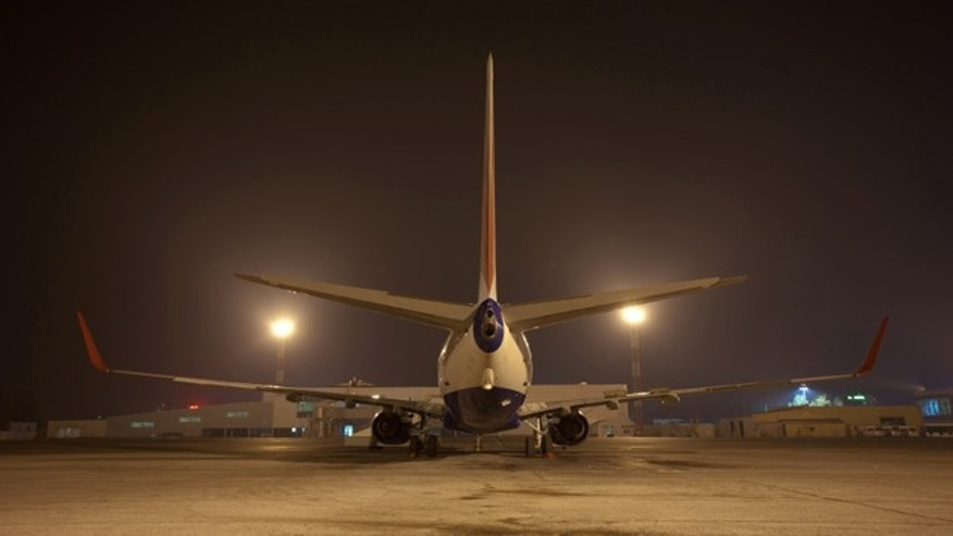 big air jet on ground at night