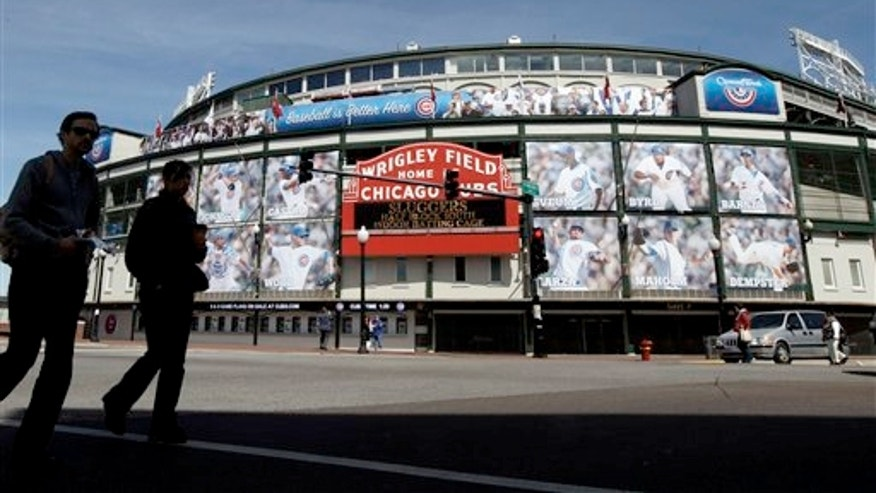April 4, 2012: People walk by the Marquee at Wrigley Field, one day before the Chicago Cubs' home opener against the Washington Nationals in Chicago.