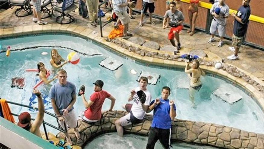 July 11, 2011: A home-run ball falls into the pool during baseball' All-Star Home Run Derby at Chase Field in Phoenix.