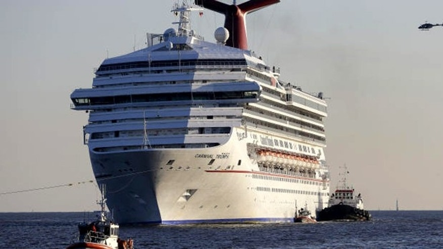 Feb. 14, 2013: The Carnival Triumph being towed into Mobile Bay, Ala.,  after it was disabled in the Gulf of Mexico following an engine room fire.
