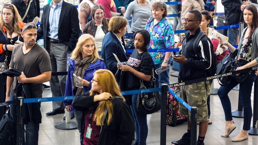 April 22, 2013: Travelers stand in line at Los Angeles International airport in Los Angeles.