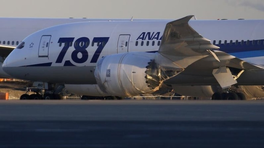 An All Nippon Airways' (ANA) Boeing Co's 787 Dreamliner plane is seen at Haneda airport in Tokyo January 29, 2013. REUTERS/Toru Hanai