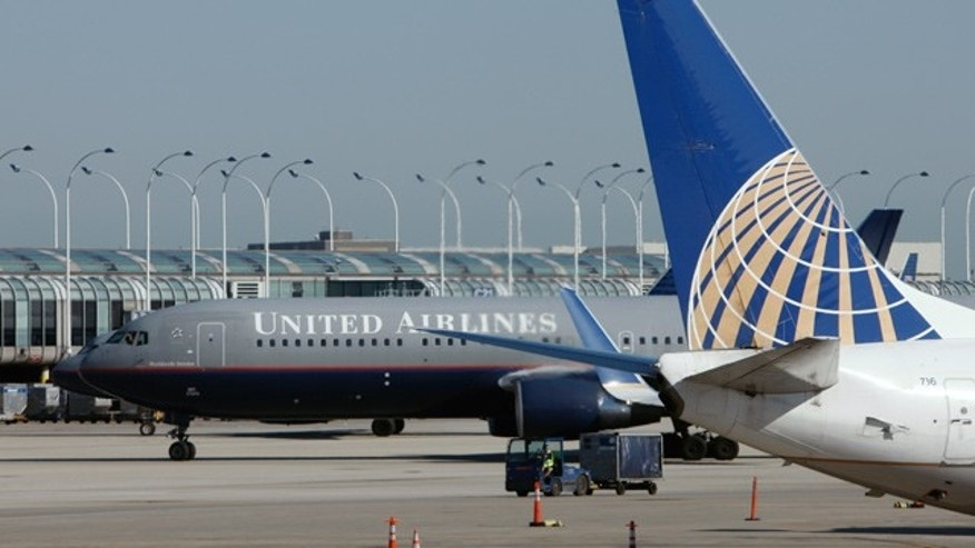 united and us airways raise ticket change fee to 200 more for