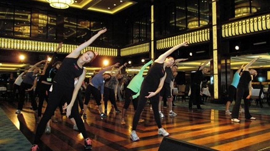 May 9, 2013: A fitness class designed by the athletic trainer for the Rockettes, Elaine Winslow, and taught to passengers aboard the Norwegian Breakaway cruise ship.