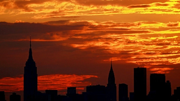 NEW YORK, NY - SEPTEMBER 10:  A general view of the sunset over the New York City skyline is seen from the Arthur Ashe Stadium on the grounds of the USTA Billie Jean King National Tennis Center during Day Thirteen of the 2011 US Open on September 10, 2011 in the Flushing neighborhood of the Queens borough of New York City.  (Photo by Nick Laham/Getty Images)