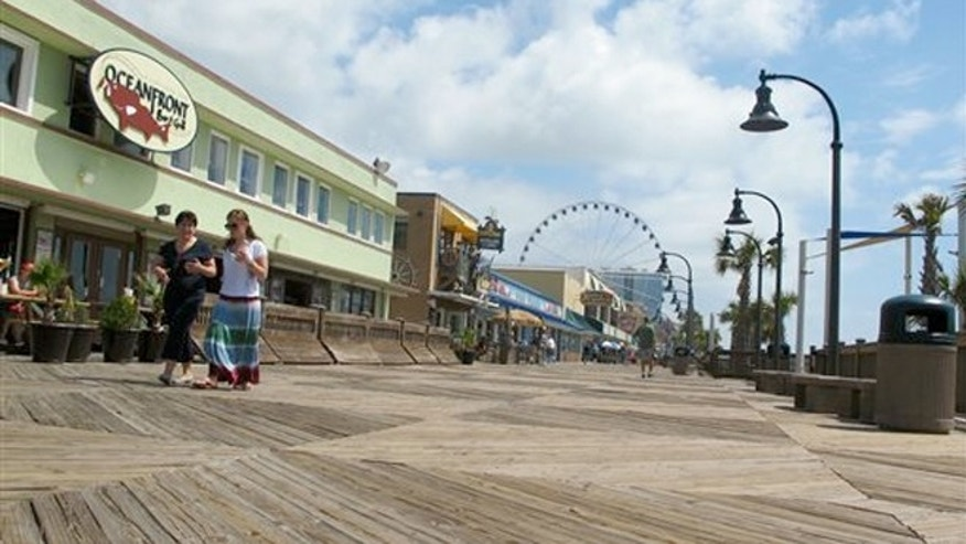 May 22, 2013:  Vacationers along the boardwalk in Myrtle Beach, S.C.