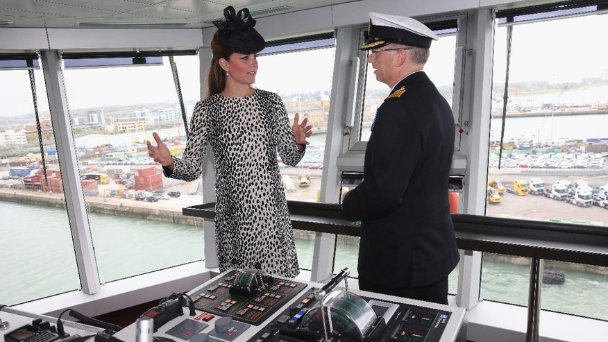 Britain's Duchess of Cambridge receives an on board tour with Captain Tony Draper during the Princess Cruises ship naming ceremony to officially name the new Royal Princess cruise liner at a gala ceremony, in Southampton, England, on Thursday.