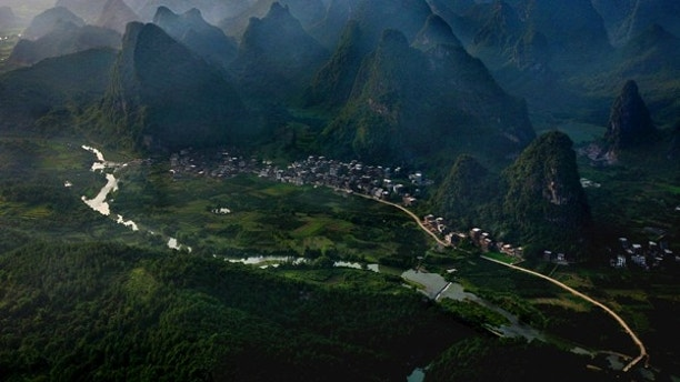 Asia, China, Yangshuo, near Guilin, Guanxi, river Li with karst mountains at sunset, aerial view . -