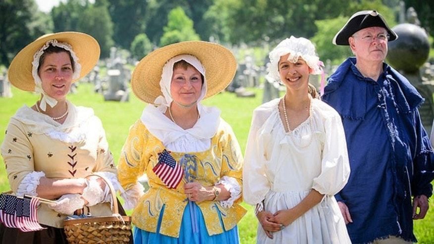 Members of the Daughters of the American Revolution and the Sons of the American Revolution came to the ceremony in period dress.