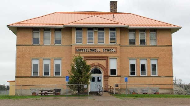 This image provided by Carroll Van West and released by The National Trust for Historic Preservation shows the Musselshell School in Montana. The trust released its 2013 list of 11 Most Endangered Historic place and historic rural schoolhouses in Montana are on the list. Montana is still using more historic one- and two-room schoolhouses than any other state, but preservationists say the school buildings are at risk because the state's population is shifting to urban centers. (AP Photo/Carroll Van West)