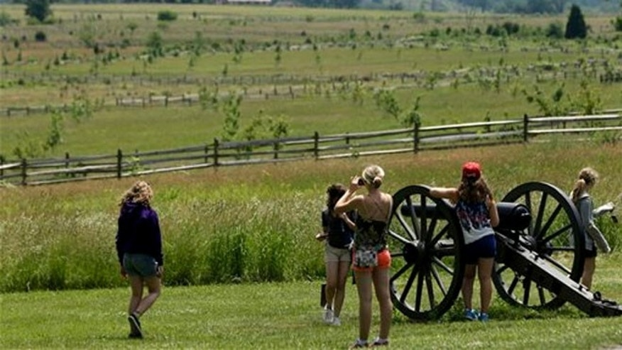 June 5, 2013: Near a Confederate artillery piece that sit atop a ridge above the field of Pickett's Charge, in Gettysburg, Pa.