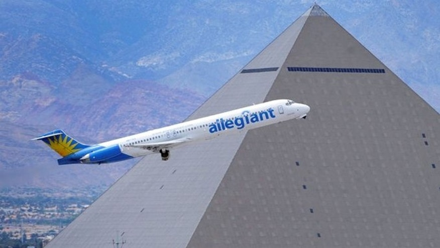 May 9, 2013: An Allegiant Air jet flies past the Luxor Resort & Casino after taking off from McCarran International Airport in Las Vegas.