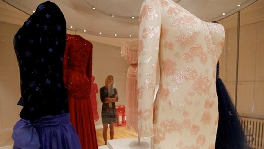 July 1, 2013: Dresses of Princess Diana are displayed at the Fashion Rules exhibition at Kensington Palace in London.