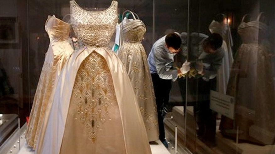 July 1, 2013: Desses worn by Queen Elizabeth II at the Fashion Rules exhibition at Kensington Palace in London.