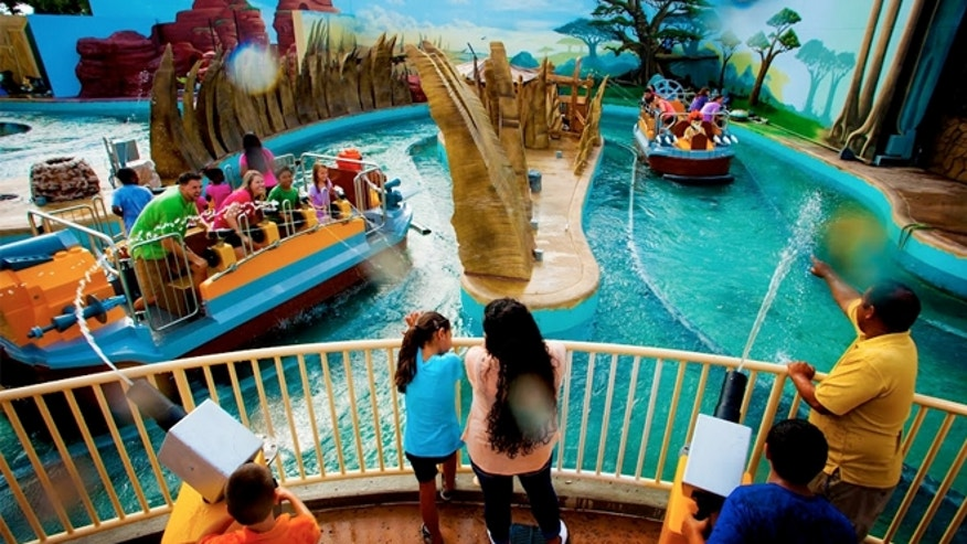 At The Quest for CHI, the centerpiece interactive splash-battle ride, families board watercraft and set off on a very wet adventure through various interactive scenes.