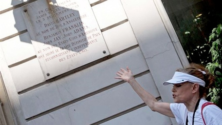 "July 19, 2013: Tour guide Shari Segall shows the marble plaque on the building used to be the Hotel d'York where ""The Treaty of Paris"" was signed by Thomas Jefferson in 1783."