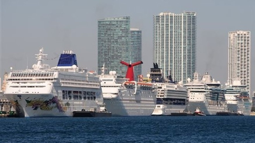 FILE: Five cruise ships are lined up at the Port of Miami, in Miami.