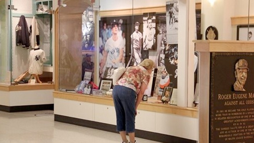 July 15, 2013: A woman looks at a display on baseball legend Roger Maris Museum in the West Acres Mall in Fargo, N.D.