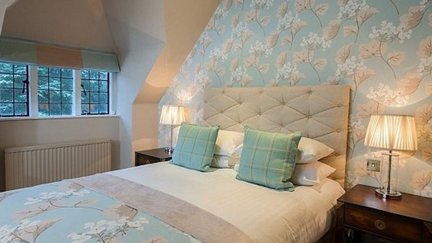 Each room is decorated with Laura Ashley fabrics and products.