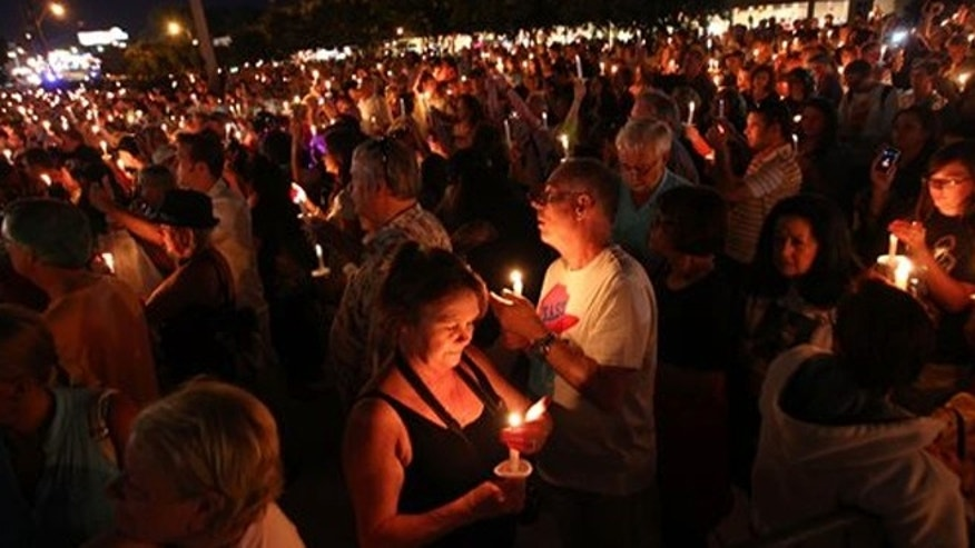 Aug. 15, 2013:  Presley fans from around the world made their annual pilgrimage to Graceland to pay their respects to the rock n' roll icon with a solemn candlelight vigil on the 36th anniversary of his death.