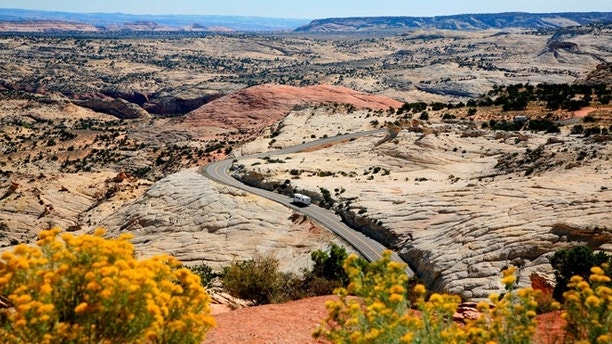 In this view you see a section of Highway 12 A Journey through Time Scenic Byway. This breath-taking view is from the Head of Rocks overlook about 10 miles east of Escalante, Utah.