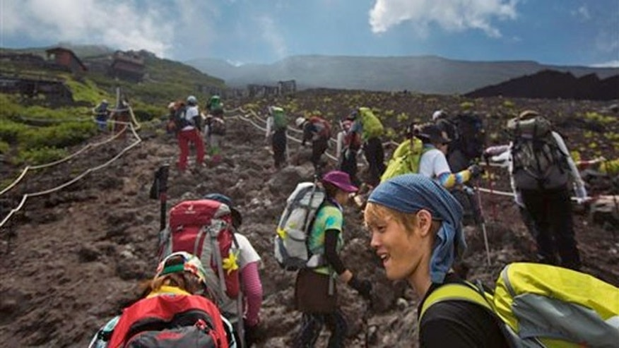 Aug. 10, 2013:  Japanese hikers climb one of the trails on Mount Fuji in Japan.