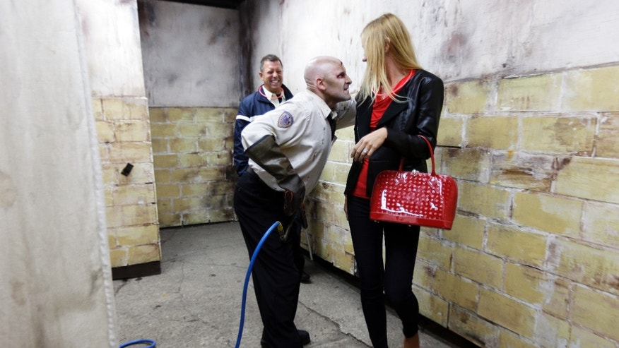 Sept. 27, 2013: Actor portraying a zombie guard interacts with a visitor during the Halloween haunted house Terror Behind the Walls, at Eastern State Penitentiary in Philadelphia