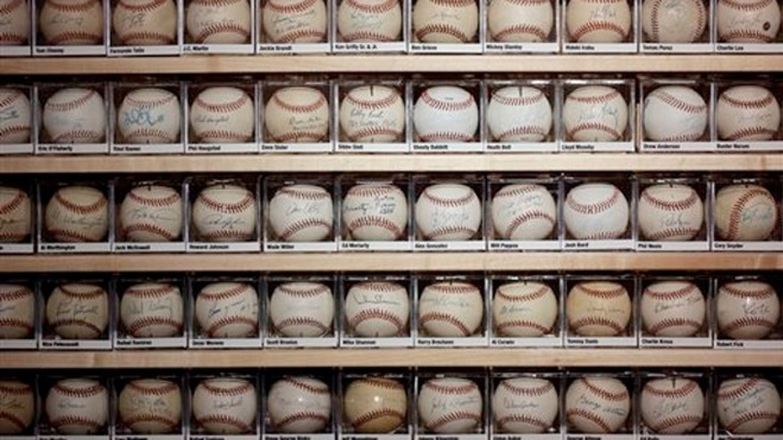Oct. 22, 2013: A portion of Dennis Schrader's autographed baseballs are seen at the St. Petersburg History Museum in St. Petersburg, Fla.
