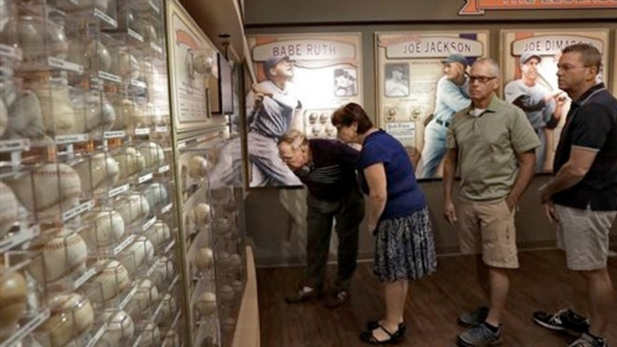 Oct. 22, 2013: Visitors to the St. Petersburg Museum of History view some of Dennis Schraders autographed baseballs.