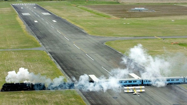 Steam Train At Airport.