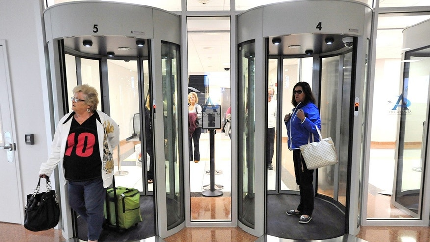 FILE:  Passengers walk through security portals at the Atlantic City International Airport in Egg Harbor Township, N.J.