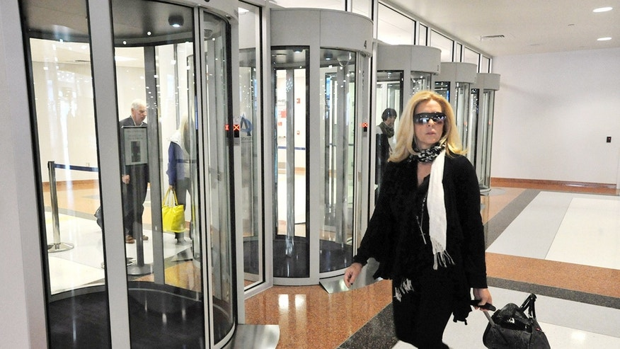 FILE: Passenger Laura West, of Red Bank, N.J., walks past security portals at the completed $27M terminal expansion project at the Atlantic City International Airport in Egg Harbor Township, N.J.