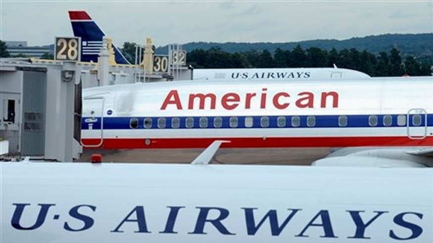 FILE:  An American Airlines plane between two US Airways planes at Washington's Ronald Reagan National Airport.