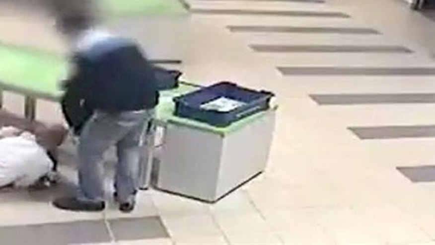A quick thinking security guard at Katowice airport in Poland saved a toddler from injury by diving to catch him before the child fell off a table.
