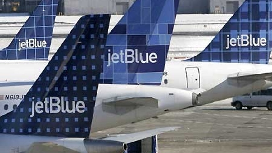 Feb. 16: JetBlue planes wait at terminal gates at JFK Airport in New York.