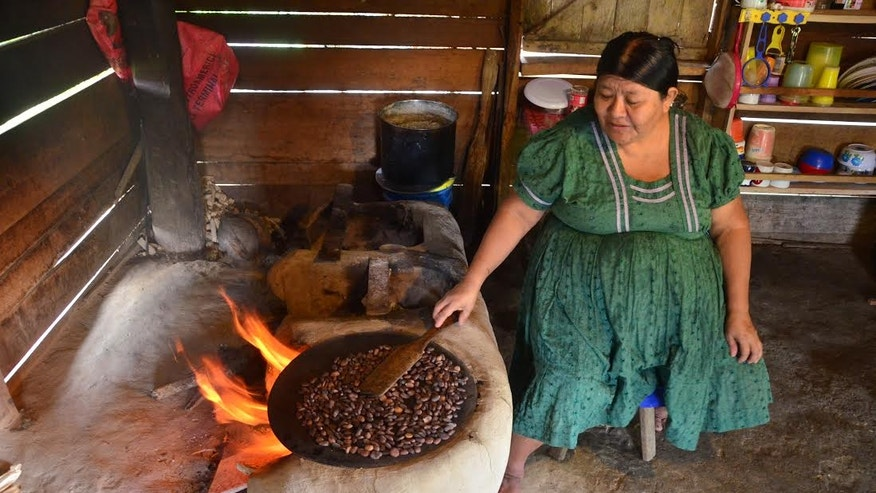 Maria Ack runs a homestay in the village of San Miguel. She shows visitors how to make corn tortillas and roast cocoa beans on a traditional wood fired griddle called a comal.