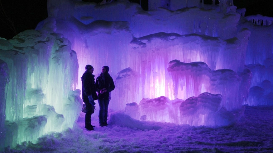 Patrons tour an ice castle at the base of the Loon Mountain ski resort in Lincoln, N.H.