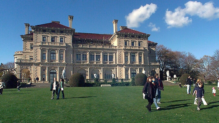 FILE -Visitors take advantage of free admission to tour The Breakers mansion in Newport, R.I.