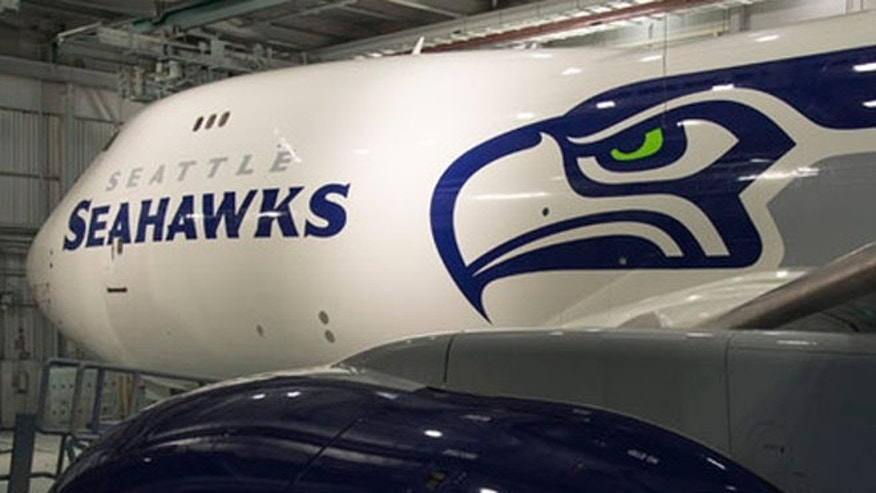 Boeing Wednesday revealed a 747-8 Freighter painted in the livery of the NFL's Seattle Seahawks.