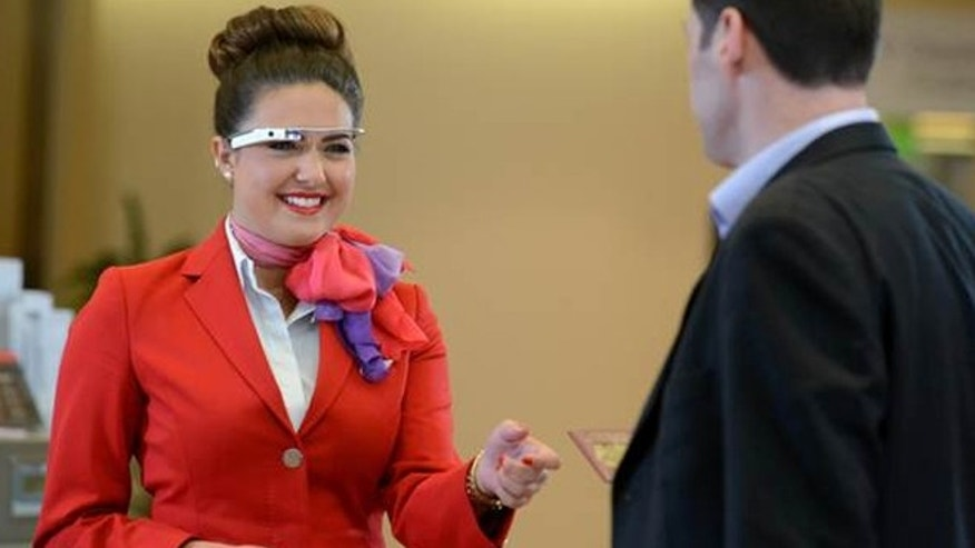 Virgin Atlantic staff are using Google Glass and other wearable technology as part of a six-week trial.
