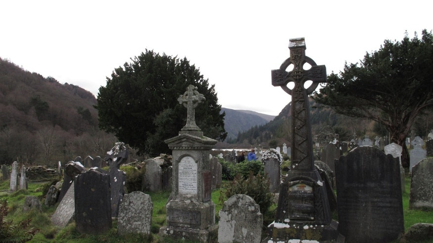 Celtic crosses and centuries-old gravestones on a sixth century monastic settlement in Glendalough, County Wicklow.
